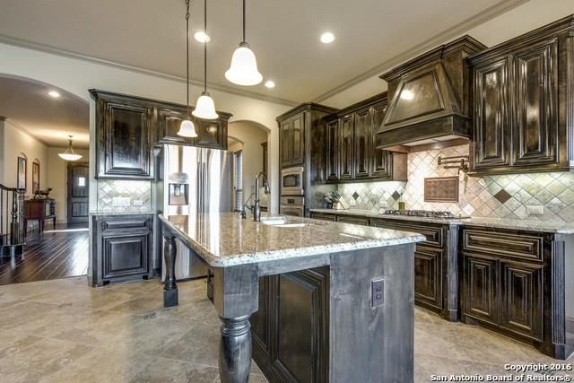 We Absolutely Love The Way The Rich Brown Knotty Alder Cabinets Are Paired  With Light Tile And Countertops In This Kitchen. We Also Love The Stainless  Steel ...